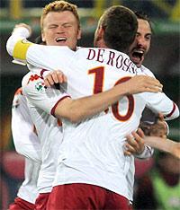 Piedino di Riise su tiro di De Rossi: gol